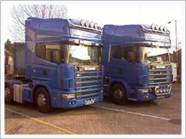 Two blue Scania articulated lorries parked up at Archers Transport Depot